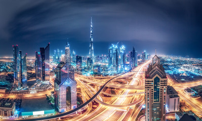 Colourful nighttime skyline of a big modern city. Dubai, United Arab Emirates. Travel background.