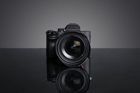 new mirrorless camera shot with gray gradiwnt background