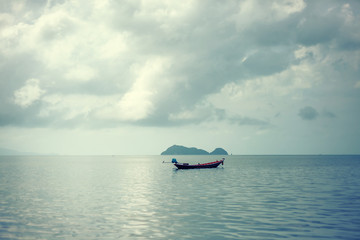 Fototapete - Traditional Thai boat in the sea in a calm, beautiful scenery, calm water, clouds, minimalism