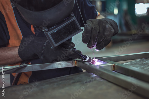 Argon Welding, Masked workers and leather gloves for safety, Argon