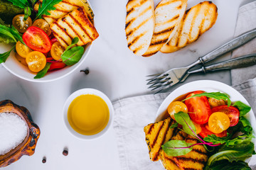 Cherry tomato salad with grilled haloumi cheese, with chard and arugula