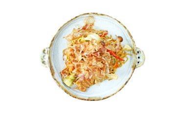 Top view fried yaki soba noodles with pork on plate isolated on white background
