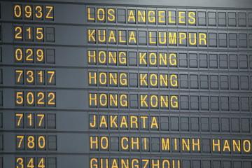 Airport departure board showing flight information