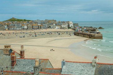 View from the train station over St Ives harbour beach.