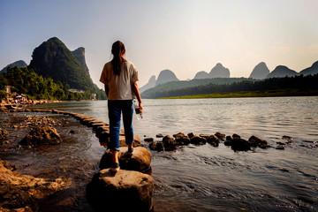 Stepping stone crossing on li river Yangshuo