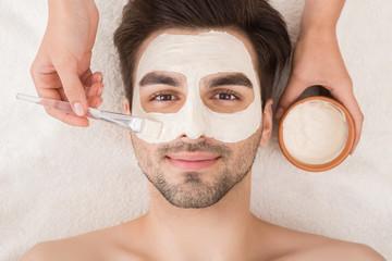 Man having cosmetic mask in spa salon - fototapety na wymiar