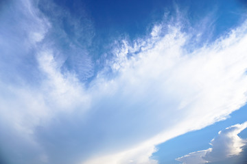 Beautiful white and gray clouds against the blue sky. Summer and autumn day with a view from the airplane to the atmosphere. Stock Photo for design