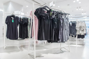 Various shop clothing in ladies' clothing store in summer