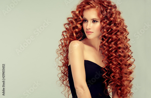 Beautiful Model Girl With Long Red Curly Hair Red Head Care And Beauty Hair
