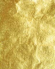 Shiny hot yellow gold foil golden color glitter decorative texture paper: Bright brilliant festive metallic textured empty wallpaper backdrop: Tin metal material for holiday craft design decoration