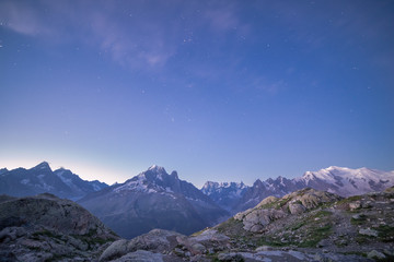 Snowy Mont-Blanc Mountains Range Peaks under Blue Starry Sky at Dawn.