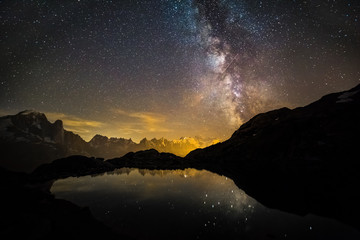Shooting Star Crossing the Milky Way over Iconic Snowy Mont-Blanc Peaks Reflecting in Mountain Lake.