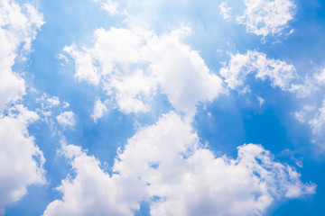The vast blue sky with large group of fluffy clouds in sunny day of summer, peaceful skies background