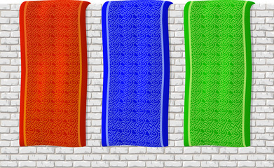 Red, green and blue banners with beautiful pattern on white brick wall background