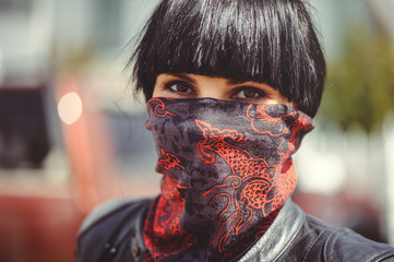 woman covers her face with a handkerchief, freedom of speech and tradition