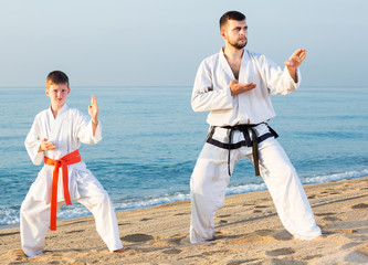 Man and boy practising karate