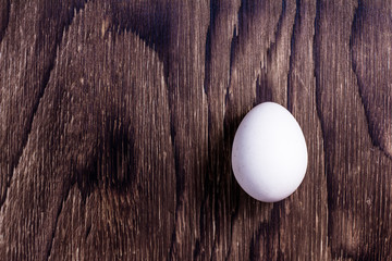 Happy Easter. Top view whole white eggs on old wooden rustic background. Copy space for text