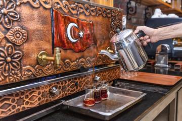 Traditional Turkish teapot by tea machine. Copper Tea Boiler. Turkish Tea house.