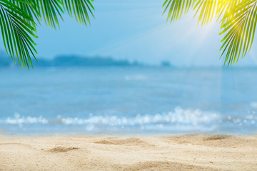 Wall Murals Palm tree Top of wood table with blurred sea and palm tree background,Concept Summer, Beach, Sea, Relax.