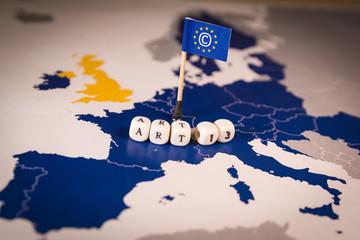 Flag with Copyright symbol over a EU map. CDSM metaphor