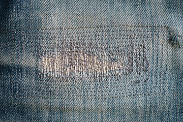 close up patch old jeans denim texture and background.