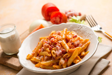 pasta with tomatoes sauce bacon and cream sauce