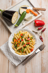 pasta with eggplants green peas zucchinis capsicum and carrot