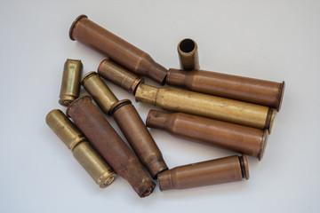 Empty shells from live ammunition to machine gun and pistol