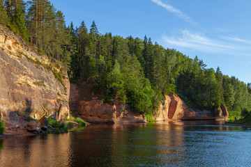 Peaceful landscape with Gauja river and red sandstone (Erglu klint) steep rocks in Gauja National Park in Valmiera area