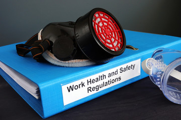 Work Health and Safety (WHS) Regulations on the desk.