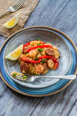 Spanish paella with prawns, chicken, chorizo and red pepper - high angle view