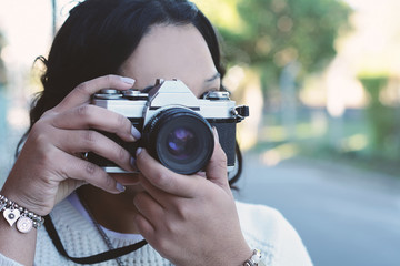 woman with old vintage camera