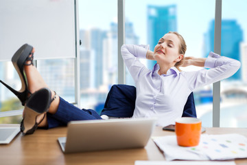 business woman relaxing or sleeping with her feet on the desk in office. female boss worker close eyes sitting with legs on the table in the resting time at work place on city background