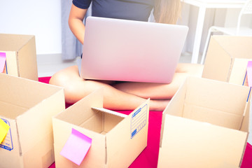 success start up business entrepreneur or freelance woman concept , typing computer with box, online marketing packaging box and delivery
