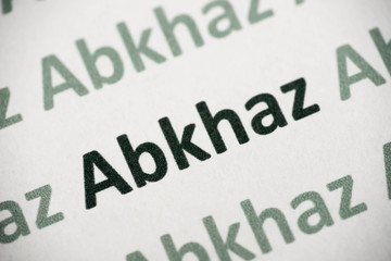 word Abkhaz  language printed on paper macro