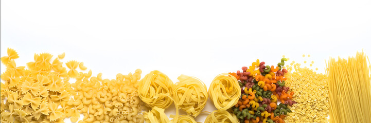 Italian pasta of various kinds on a white background. Flat lay, top view. Laid out in line. Banner