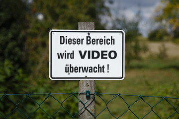 Metal sign this area is video monitored