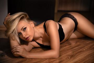 Beautiful blonde model posing on the floor