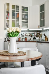 Bouquet of tulips in interior of the kitchen