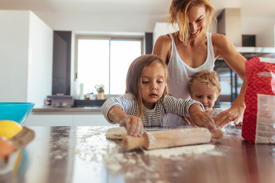 Family making cookies in kitchen