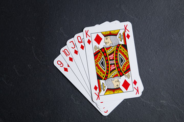 Poker cards on a dark background. Straight in color.
