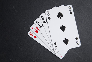 Poker cards on a dark background. Four cards with the same value.