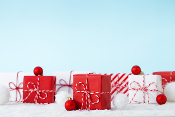 Christmas gifts in a white and red color on a blue background.