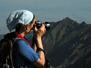 Hiker taking photos in the mountains