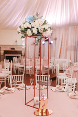 Table 11 set for wedding or another catered event dinner. Luxury decorated with natural flowers. Vertical view photo