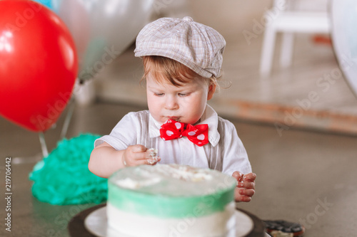 Baby Boy In Hat Eating First Birthday Cake Close Up Portrait