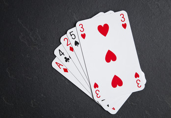 Poker cards on a dark background. High card layout.