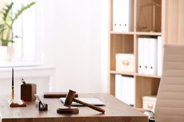 Table with judge gavel in lawyer's office