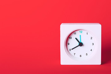 white clock on a red background