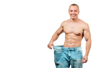 Man wearing big jeans after diet, weight loss